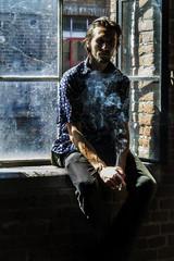 Lukasz Mrozinski (Indiesigh Ph) Tags: italy musician window wall docks torino smoke atmosphere independent mrozinski turin atmosfera interno musicista fumo lukasz 2015 indiesigh