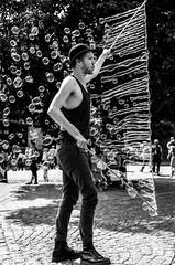 Soap Bubble Man (Blasius Kawalkowski) Tags: street city portrait bw white man black hat 35mm photography soap artist fotografie faces candid cologne bubbles köln scene snap blow hut mann moment unposed decisive bursting seifenblasen strassenfotografie strasenkünstler