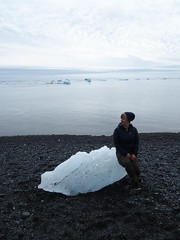 Anette sitting on one of The chunks of ice from Vatnajøkull!
