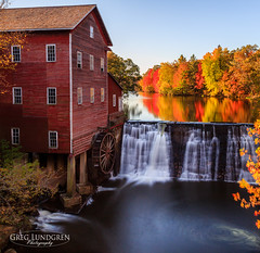 Autumn on the Mill Pond (Greg Lundgren Photography) Tags: longexposure morning autumn red orange reflection yellow wisconsin rural landscape mirror waterfall pond midwest antique dam fallcolors americana dellsmill greglundgren