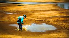MudKing (Michael Angelo 77) Tags: boy fun mud splashingwater