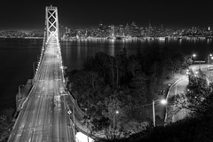 Upper Deck (eCHstigma) Tags: sanfrancisco city longexposure bridge blackandwhite water monochrome skyline architecture night landscape lights bay cityscape fuji coittower bayarea sfbayarea bnw transamericapyramid xseries xpro1 xf23mmf14r