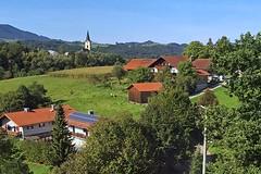 Approaching Austria (AntyDiluvian) Tags: trip salzburg train germany munich deutschland bavaria town ride db steeple german deutschebahn muenchen 2015