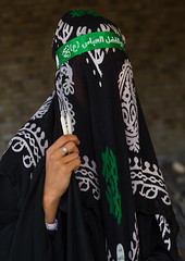 iranian shiite muslim woman mourning imam hussein on the day of tasua with her face covered by a veil, Lorestan Province, Khorramabad, Iran (Eric Lafforgue) Tags: portrait people woman green face vertical proud mystery female outdoors persian clothing women veil mourning adult iran muslim islam traditional religion middleeast headshot celebration hidden covered mysterious shia muharram ashura calligraphy script tradition bandana niqab hussein oneperson burqa iman shiite ashoura hussain mourner 20sadult persiangulfstates onewomanonly   15459 tasua husayn colourimage 1people  iro shiism arabicalphabet khorramabad  tasoua unrecognizableperson westernasia  lorestanprovince chehelmenbari
