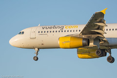 Vueling Airbus A320-232 EC-LRM (Mark_Aviation) Tags: sunset sky sun ex clouds newcastle airplane airport aircraft aviation aeroplane landing international 25 airbus approach airlines runway approaching aerospace a320 arriving ncl iag spanair vueling a320200 a320232 egnt eclrm
