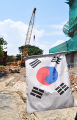Korean construction (Roving I) Tags: banners symbols korea buildingsites dirt earth cranes construction marriott hotels danang vietnam vertical hilton