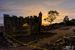 The Fire In Which We Burn (Tim van Zundert) Tags: gwrych castle ruin abergele conwy llandundno north wales derelict abandoned country house night evening long exposure light pollution tree sony a7r voigtlander 21mm ultron architecture