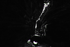 Step into the Light (Ben Lockett) Tags: luds church chasam ca gorge canyon stone rock person self silhouette light dark noise photoshop stylise canon 1740l 5d woodland darkness mystery dramatic mysterious