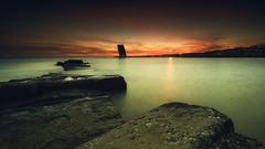 The sentinel (Joo Cruz Santos) Tags: longexposure seascape alges portugal sunset nex5r sel1018