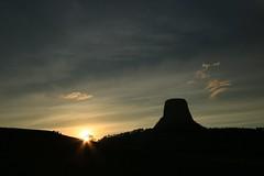 You butte (alideniese) Tags: devilstower devilstowernationalmonument wyoming usa butte silhouette landscape sunset sun sunburst sundown evening dusk sky clouds treeline