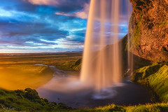 Blinded by the Light (Hilton Chen) Tags: iceland seljalandsfoss spray mist warmtones longexposure grass rocks bluesky