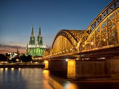 Cologne Cathedral (v-_-v) Tags: köln nordrheinwestfalen germany de cologne dom rhine rhein church blue hour river water building lights travel europe architecture green yellow bridge hohenzollernbrücke explored