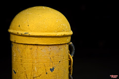 Mellow Yellow (MBates Foto) Tags: color industrial yellow minimalist aged old warn damaged contrast blackbackground availablelight existinglight nikon nikonf nikond810 nikkor24120mm outdoors spokane wasshington unitedstates 99201