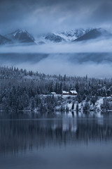Bowron Lake (robertdownie) Tags: trees canada lake forest mountains winter water reflection cold clouds gold snow woods ice bc hills cabin wilderness british columbia remote mountans wells barkerville bowron cariboo