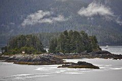 Rugged small islands on the coast of Alaska (Pejasar) Tags: woods islands trees boats flag red coast alaska pacific rugged rocks