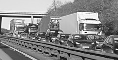 Bank Holiday Traffic. (ManOfYorkshire) Tags: road motorway traffic accident stop carriageway bridge doncaster southyorkshire queue queuing long bw blackwhite sun low winter sunvisor ford landrover fiat volkswagen vw lorry truck scania peugeot