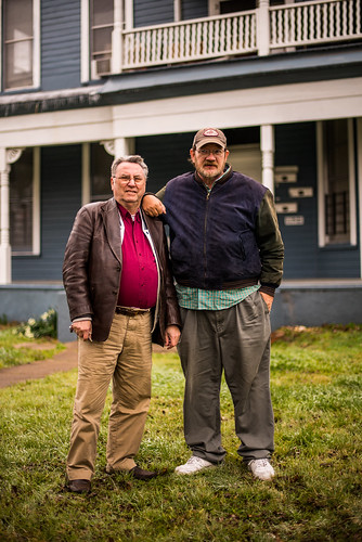 Clive and Ron outhside their house 2015