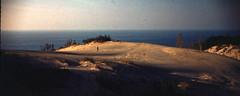 Walking on the Dune (joeldinda) Tags: sky people cloud tree forest person woods dune slide lakemichigan greatlakes hills notbyme scanned 1961 argus c3 rogerdinda 2958