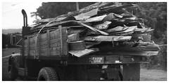 FARM USE (daveelmore) Tags: farmuse dumptruck truckload truck wood woodpile lumber blackwhite bw manualfocus legacylens penfm43adapter hzuiko42mm112 stitchedpanorama panorama