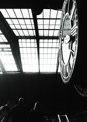 Hand Held in Black and White (sjpowermac) Tags: station couple clock stationclock time roof romannumerals footbridge railwaystation york handrails handheld catching train steps 1877 1938 1611 leatherjacket highlights railway passengers
