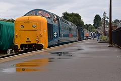 Deltic Locomotive 55019 reverses onto its train, at Ongar, in readiness for the return to North Weald. Epping Ongar Railway. 08 10 2016 (pnb511) Tags: eppingongarrailway trains heritage railway locomotive loco rail diesel class55 deltic ongar station wet reflection