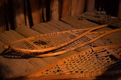 Longhousea at Iroquoian Village, Crawford Lake Conservation Area, Ontario (teachandlearn) Tags: indoor architecture longhouse road canada iroquois village ontario wood tools monochrome snowshoes