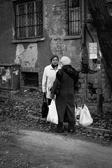 The grandma saw me... (dragonllabroe) Tags: grandma grandmas grandmother shopping bags old communist ruined cobblestone gravel stalin black white blackandwhite monochrome street report outside outdoor journalism