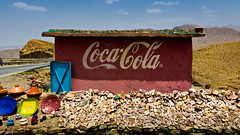 We follow you to the end of the world... (soundmoods) Tags: morocco coke cola advertising atlas mountains red culture drink paint