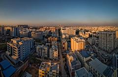 Hyderabad at Sunset (Dave Sexton) Tags: hyderabad telangana india in city skyline westin hotel sunset golden hour haze smog panorama ultra wide angle samyan 14mm f28 pentax k1