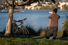 the painters view (heavysoulclick) Tags: color street photography bokeh canon5d 500mm nikkor nikoneos adapter lake merritt park grass hats tattoo hair shorts back shade shadow quiet sunny day urban cityscape skyline