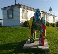 Gorilla sculpture near the seafront (southglosguytwo) Tags: 2016 autumn buildings cameraphonephoto devon october torbay paignton gorillasculpture grass signs