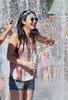 Cooler (peterkelly) Tags: digital canada northamerica womenexpression montreal quebec 2016 osheaga osheagamusicartsfestival festival fountain sunglasses woman tiedye smiling smile laughing laughter headband beautiful water wet shorts
