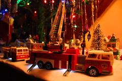 Emergency bulb repair (cheliman) Tags: toys majorette firetruck diecast christmas village holidays christmaslights laddertruck vintage