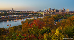 St. Paul Skyline in the Fall (lpvisuals.com) Tags: city sunset red urban orange usa fall robert colors leaves minnesota yellow skyline architecture skyscraper river mississippi boat leaf cityscape seasons stpaul minneapolis arches foliage riverboat powerline wellsfargo saintpaul bluff goldenhour highbridge sciencemuseumofminnesota ecolab harrietisland xcelenergycenter explored exploreminnesota sonya7 1stbuilding centurylink captureminnesota sonya7ii fe1636mmf4