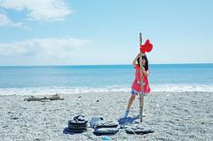 Secret Base ( aikawake) Tags: ocean blue red portrait sky fall beach beauty hat stone fun kid child play outdoor secret innocent sunny skirt cap stunning littlegirl  naive base ricohgr naivete taiwanese sunnyday   fairness   loveliness pulchritude  artless littlechild    goodliness