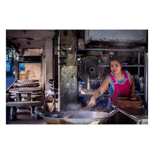 Thai lady preparing before opening her restaurant. Most places open at 5pm to avoid the heat during the day. In the evenings streets are full, everyone sits outside enjoying a meal.  #Thai #Thailand #street #Thaistreet #chiangmai #streetfood #streetphoto