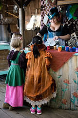 Princess and the Paint (russwynn) Tags: minnesota renaissance festival vendor painter three girls teaching
