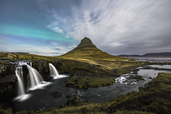 Northern Light over Kirkjufell, Iceland (Alongkot.S) Tags: arctic aurora beautiful beauty borealis celcius cloud cloudy cold freeze green grund grundarfjordur ice iceland kirkjufell kp9 lake landmark landscape light magical max miracle mountain natural nature night nightscape north northern phenomenon planet polar scene scenic sky snow solar spread star swamp travel water waterfall wave west winter wonderful