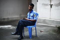 Caught Napping (N A Y E E M) Tags: khokon securityguard nap outpost driveway ramadan lateafternoon hotel radissonblu chittagong bangladesh carwindow