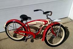 1055 (centerprairie) Tags: red 1948 bicycle stand tank balloon ivory tire chrome spitfire brake pedals handlebar horn schwinn coaster juvenile rods 1949 saddle dx truss grips bendix 20