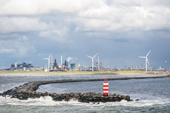 Leaving IJmuiden (G. Warrink) Tags: sea industry water clouds landscape coast industrial windmills northsea breakwater