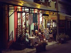 IMG024.jpg (andrei_pietru) Tags: cinestill nikon f4 night people shop 50mm