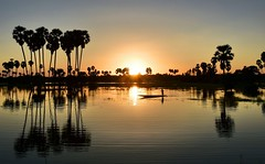 A Sunset in Thailand (Tungmay aka ) Tags: sunset thailand lake water boat palmtrees reflections serene calm