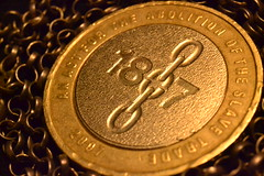 Equal (mitchell_dawn) Tags: money macro gold chains coin humanrights slavery chained equal £2 slavetrade humanrightsday 1807 flickrfriday abolitionofslavery aminotamanandabrother