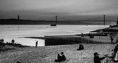 Being Alive in Lisbon (Nuno M.S. Martins) Tags: bridge sunset people urban bw portugal monochrome architecture clouds river landscape lisbon