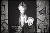 #15 (The White Saint & The Sinner Lady) (Robbie McIntosh) Tags: leicamp leica mp rangefinder streetphotography 35mm film pellicola analog analogue negative leicam summilux analogico leicasummilux35mmf14i blackandwhite bw biancoenero bn monochrome argentique summilux35mmf14i dyi selfdeveloped filmisnotdead autaut wideopen f14 ilforddelta400 ilford delta 400 arsimagofd arsimagofddeveloper eyecontact woman sangennaro sacred prophane sr106