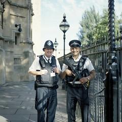 Kind men (Gabriela Gleizer) Tags: england united kingdom uk london urban street policeman police guard smiling men man film analog mamiya c330 fujicolor 160ns 120mm medium format twin lens tlr abingdon st parliament
