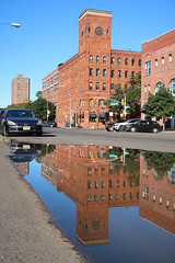 Piano Factory Reflection (jschumacher) Tags: nyc bronx thebronx motthaven portmorris puddle reflection