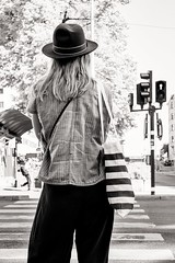waiting for the green light (Gerard Koopen) Tags: zweden sweden stockholm city capital bw blackandwhite straatfotografie streetphotography straat street candid woman girl waiting stripes fujifilm fuji xpro1 35mm 2016 gerardkoopen