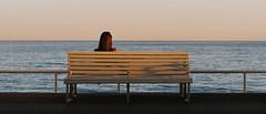 #032 (Matthew Hopper) Tags: 35mmfilm europe france colour beach summer 2014 nice southoffrance bench sunset kodak canon girl woman pensive thoughts calm sea tranquil